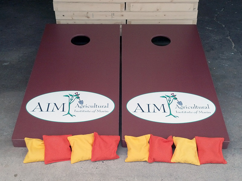 Custom cornhole game boards & bags with Agricultural Institute of Marin logo – by IWI Wood Products