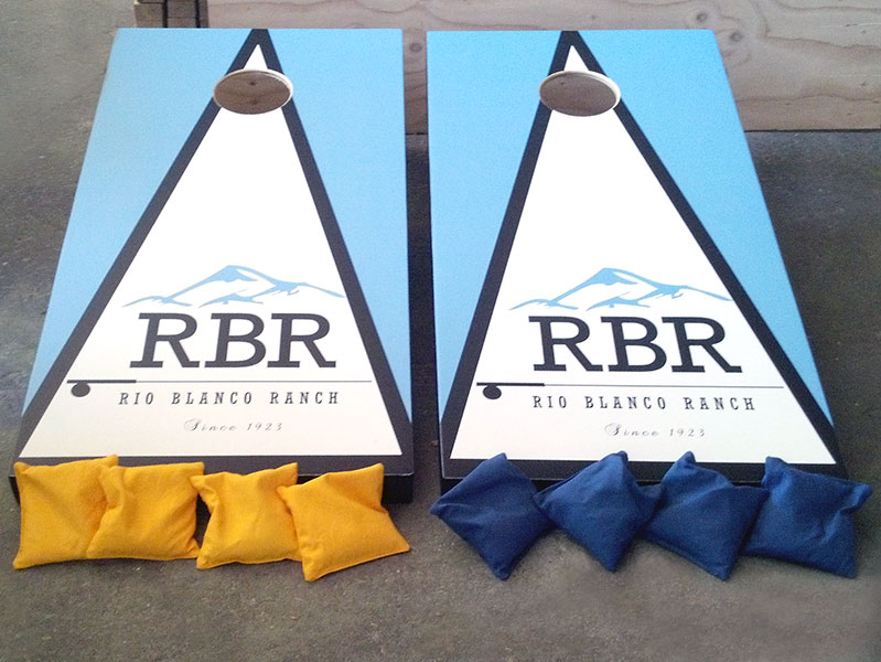 Custom cornhole game boards & bags with Rio Blanco Ranch logo – by IWI Wood Products