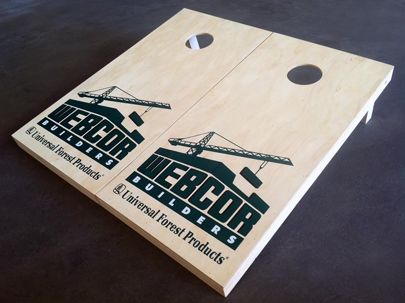 Custom cornhole game boards & bags with Webcor Builders logo – by IWI Wood Products